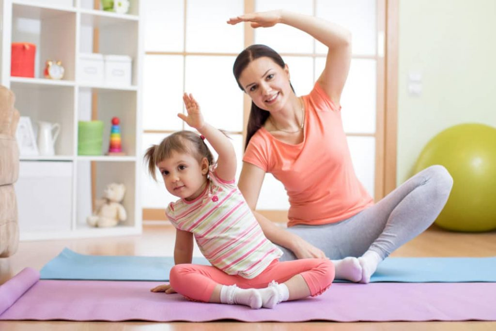 mom and daughter stretching for exercises